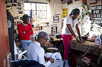 SOWETO, SOUTH AFRICA JULY 3: Sibu Sithole (r), a young designer part of the group Smarteez work on a collection with his colleague Lethabo Tsatsinyane in their workshop on July 3, 2014 in Jabulani section of Soweto, South Africa. Soweto today is a mix of old housing and newly constructed townhouses. A new hungry black middle-class is growing steadily. Many residents work in Johannesburg but the last years many shopping malls have been built, and people are starting to spend their money in Soweto. (Photo by: Per-Anders Pettersson)