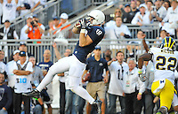 12 October 2013:  Penn State TE Jesse James (18) catches a touchdown pass in the end zone during the first half. The Penn State Nittany Lions defeated the Michigan Wolverines 43-40 in 4OTs at Beaver Stadium in State College, PA.