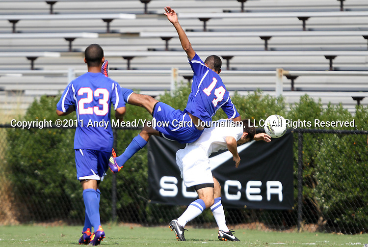 04 September 2011: SMU's Aaron Simmons (14) falls over Duke's Christopher Tweed-Kent (in white). The Southern Methodist University Mustangs defeated the Duke University Blue Devils 1-0 in overtime at Koskinen Stadium in Durham, North Carolina in an NCAA Division I Men's Soccer game.