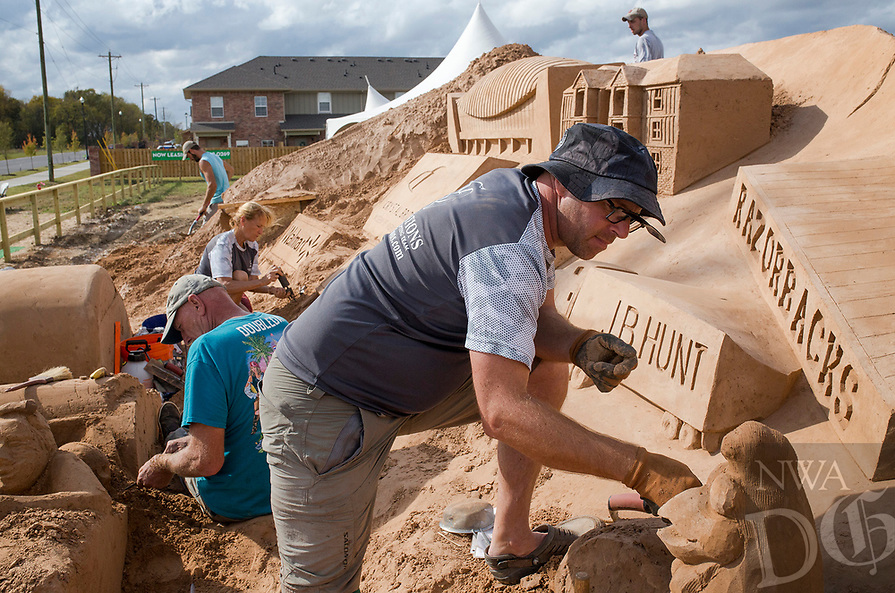 NWA Democrat-Gazette/CHARLIE KAIJO Artist Wilford Stijger builds a sand sculpture on Saturday, October 21, 2017 at Sullivan Square in Bentonville. Four artists started the sand project on Monday that will involved about 275 hours of building time and 280 tons of sand.