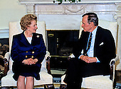United States President George H.W. Bush, right, meets former Prime Minister Margaret Thatcher of Great Britain, left, in the Oval Office of the White House in Washington, D.C. prior to awarding her the Presidential Medal of Freedom, the highest civilian honor awarded by the U.S. on March 7, 1991.  <br /> Credit: Howard L. Sachs / CNP