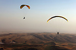 Members of Falcon Aviation Club paragliding near Mosul, Iraq, June 10, 2010. Members of the club have watched the club's fortunes rise and fall with Iraq's, achieving a World Championship in paragliding in 1980 and losing nearly all their equipment when the club was looted after the 2003 invasion.