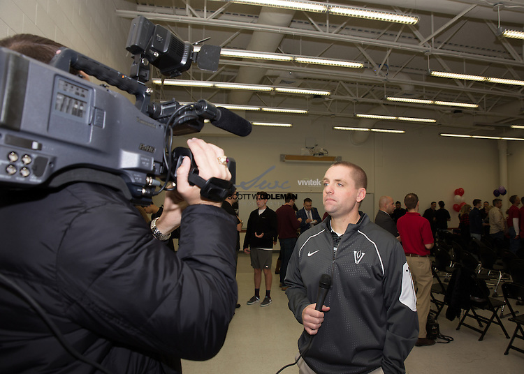 Vandegrift High School head football coach and athletic coordinator Drew Sanders talks with members of the media about the seniors signing letters of intent to continue their athletic careers at the collegiate level on  National Signing Day, Feb. 3, 2016.