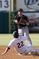 Chris Bisson #29 of the Lake Elsinore Storm turns a double play against the Lancaster JetHawks at Clear Channel Stadium on May 11, 2012 in Lancaster,California. (Larry Goren/Four Seam Images)