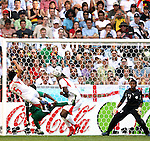 14 June 2006: Zied Jaziri (TUN) (5) jumps on a loose ball and drives it into the left side of the net in the 23rd minute to give Tunisia a 1-0 lead. Tunisia tied Saudi Arabia 2-2 at the Allianz Arena in Munich, Germany in match 16, a Group H first round game, of the 2006 FIFA World Cup.