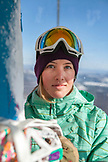 USA, California, Mammoth, snowboarder patiently rides the chairlift to the top of the run