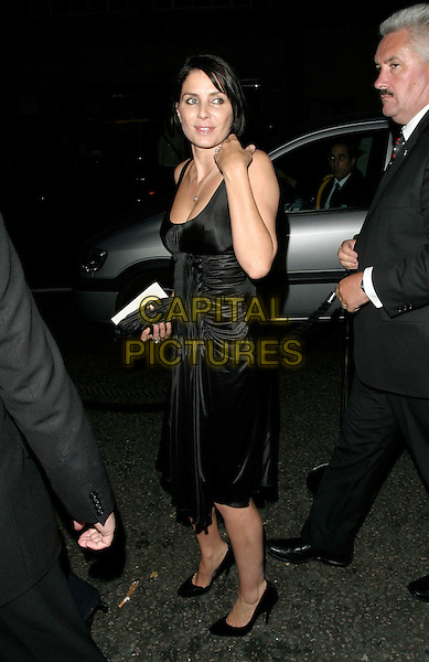 SADIE FROST.Launch party for the 21st anniversary issue of Elle Magazine at the Versace Store in Sloane Street, London, UK..September 7th, 2006.Ref: AH.full length black dress.www.capitalpictures.com.sales@capitalpictures.com.©Adam Houghton/Capital Pictures.