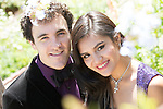 Outdoor close-up portrait from above of a White couple through tree branches
