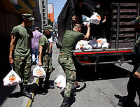 MEDELLIN, COLOMBIA, APRIL 28: Activists, soldiers and police members organize markets to be distributed in a poor neighborhood on April 28, 2020. In Medellín, Colombia. The campaign in Medellín of the ¨Salvar vive ¨ Foundation has benefited the low-income families due to the COVID19 pandemic. (Photo by Fredy Builes/VIEWpress)