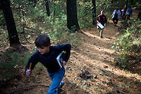 Sixth grade students from Roger Williams Middle School in Providence, Rhode Island, walk along a trail at the Powder Mill Ledges Wildlife Refuge in Smithfield, Rhode Island, on Oct. 20, 2011. The students are part of the EcoExplorer program run by the Providence After School Alliance, which helps to kids in learning environments outside of school time.  <br /> The students make a weekly visit to the refuge, operated by the Rhode Island Audubon Society, to learn about nature and ecology.<br /> <br /> M. Scott Brauer for Education Week