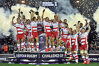 Billy Twelvetrees of Gloucester Rugby lifts the European Rugby Challenge Cup trophy in celebration. European Rugby Challenge Cup Final, between Edinburgh Rugby and Gloucester Rugby on May 1, 2015 at the Twickenham Stoop in London, England. Photo by: Patrick Khachfe / Onside Images