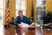 United States President Bill Clinton delivers his weekly live radio address from the Oval Office of the White House in Washington, DC on Saturday, December 18, 1993.  In his remarks, the President spoke of the economy and the progress made during the first months of his administration.<br /> Credit: White House via CNP