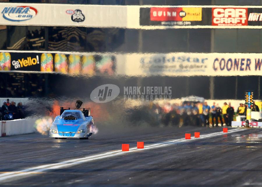 Feb 8, 2014; Pomona, CA, USA; NHRA funny car driver Terry Haddock during qualifying for the Winternationals at Auto Club Raceway at Pomona. Mandatory Credit: Mark J. Rebilas-