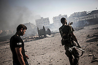 Opposition fighters arrive to their post some minutes after a Syrian aircraft bombed the rebel compound at Hanano residential neighborhood in north of Aleppo city.