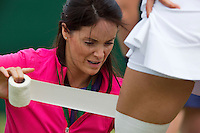 England, London, 26.06.2014. Tennis, Wimbledon, AELTC, Taping a layer<br /> Photo: Tennisimages/Henk Koster