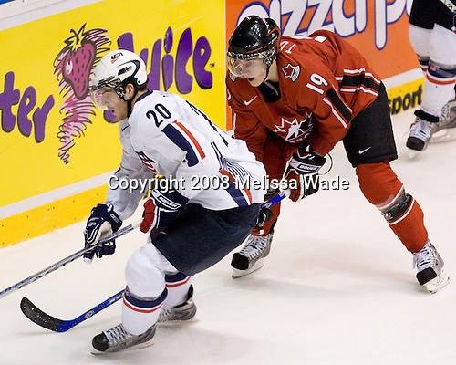 Bobby Sanguinetti (USA 20) and Kyle Turris (Canada 19) battle. Team Canada defeated Team USA 4-1 on Friday, January 4, 2008, during the World Junior Championship at CEZ Arena in Pardubice, Czech Republic.  The result put Team Canada into the gold medal game and Team USA into the bronze medal game. Sanguinetti plays for the Brampton Battalion and was drafted 21st overall in 2006 by the New York Rangers while Turris plays for the University of Wisconsin Badgers and was drafted third overall in 2007 by the Phoenix Coyotes.