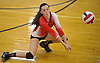 Casey Gannon #15 of St. John the Baptist makes a dig during a CHSAA varsity girls volleyball match against Sacred Heart Academy at St. John the Baptist High School in West Islip on Thursday, Oct. 12, 2017. Sacred Heart won the match 3-0.