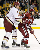 Brian Boyle (Boston College - Hingham, MA) defends against Mike Taylor (Harvard University - Maple Grove, MN) - The Boston College Eagles defeated the Harvard University Crimson 3-1 in the first round of the 2007 Beanpot Tournament on Monday, February 5, 2007, at the TD Banknorth Garden in Boston, Massachusetts.  The first Beanpot Tournament was played in December 1952 with the scheduling moved to the first two Mondays of February in its sixth year.  The tournament is played between Boston College, Boston University, Harvard University and Northeastern University with the first round matchups alternating each year.