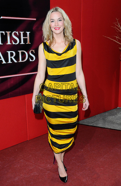 ALICE COULTHARD .Arrivals - the British Soap Awards 2009, BBC Television Centre, Wood Lane, London, England..May 9th 2009.soaps tv full length black yellow bee wasp striped stripes sleeveless dress clutch bag shoes .CAP/FIN.©Steve Finn/Capital Pictures.