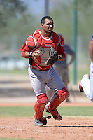 Cincinnati Reds catcher Jose Duarte (67) throws down to first during an instructional league game against the Cleveland Indians on September 28, 2013 at Goodyear Training Complex in Goodyear, Arizona.  (Mike Janes/Four Seam Images)
