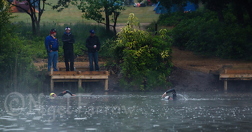 11 JUN 2011 - BRANSGORE, GBR - Support crew members Paul Moore, Paul Thompson, Angie Padley and John Padley watch their competitors during the swim at the Enduroman Ultra Triathlon Championships (PHOTO (C) NIGEL FARROW)