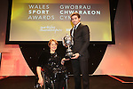 Wales Sport Awards 2013<br /> Baroness Tanni Grey-Thompson presents the BBC Wales Sports Personality of the Year trophy to Leigh Halfpenny.<br /> 09.11.13<br /> ©Steve Pope-SPORTINGWALES