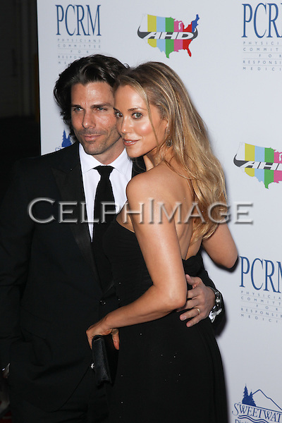 GREG LAUREN, ELIZABETH BERKLEY. Red Carpet arrivals to The Art of Compassion PCRM 25th Anniversary Gala at The Lot in West Hollywood. West Hollywood, CA, USA. April 10, 2010.