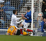 Annan's David Hopkirk squeezes the ball between Neil Alexander and Lee Wallace to score the second goal for the visitors and consign Rangers to a home defeat