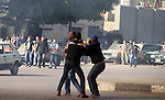 Muslim Brotherhood supporters beat a protester in Tahrir Square, as supporters and opponents of Egypt s Islamist president battle in Cairo, Egypt, Friday, April 19, 2013. Clashes erupted Friday between several hundred opponents and supporters of Egypt s Islamist president, Mohammed Morsi during a rally by his allies calling on him to cleanse the judiciary of alleged supporters of the old regime. Photo by Tareq Gabas