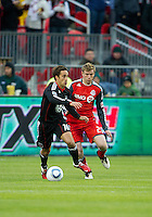 16 April 2011: Toronto FC midfielder Jacob Peterson #23 and D.C. United forward Josh Wolff #16 in action during an MLS game between D.C. United and the Toronto FC at BMO Field in Toronto, Ontario Canada..D.C. United won 3-0.