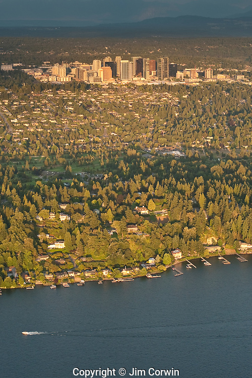 Aerial view of the Bellevue skyline at sunset with boat on Lake Washington