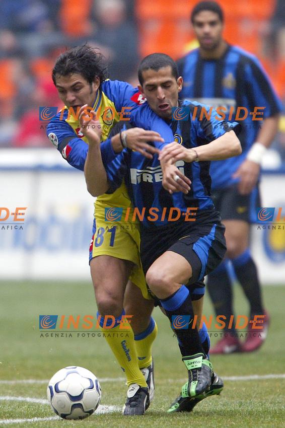 Milano 14/3/2004 Campionato Italiano Serie A - <br /> 25a Giornata - Matchday 25 <br /> Inter Chievo 0-0 <br /> Mario Alberto Santana (Chievo) and Sabri Lamouchi (Inter)<br /> Photo Andrea Staccioli Insidefoto