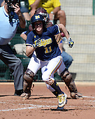 Michigan Wolverines Softball outfielder Lyndsay Doyle (11) runs to first during a game against the Bethune-Cookman on February 9, 2014 at the USF Softball Stadium in Tampa, Florida.  Michigan defeated Bethune-Cookman 12-1.  (Copyright Mike Janes Photography)