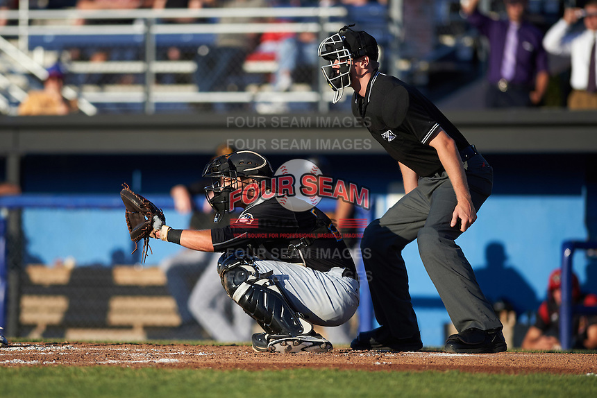 West Virginia Black Bears catcher Arden Pabst (52) and umpire Louie Krupa during a game against the Batavia Muckdogs on June 29, 2016 at Dwyer Stadium in Batavia, New York.  West Virginia defeated Batavia 9-4.  (Mike Janes/Four Seam Images)