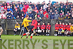 D. O'Connor(3) of Tarbert  tries to block Listowel Emmets Noel Kennelly(14) in the North Kerry Senior Football Final held last Sunday in Bob Stack Park, Ballybunion.