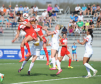 Boyds MD - April 13, 2014: Toni Pressley (3) of the Washington Spirit heads the ball.  The Western New York Flash defeated the Washington Spirit 3-1 in the opening game of the 2014 season of the National Women's Soccer League at the Maryland SoccerPlex.