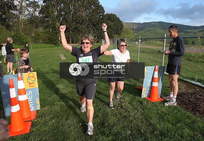 Shirley Beggs just pips Patricia Taylor at the finish line. South Island Masters Games Cross Country Run/Walk Tuesday 18/10/11.Evan Barnes / Shuttersport