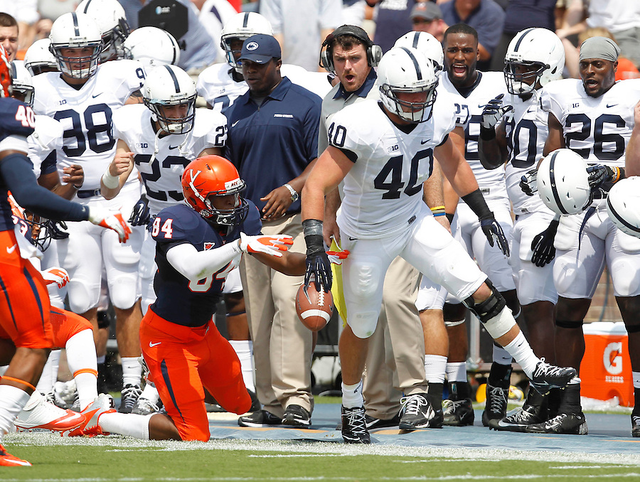 Penn State linebacker Glenn Carson (40) is pushed out of bounds by Virginia wide receiver Canaan Severin (84) after making an interception during the first half of an NCAA football game Saturday Sept. 8, 2012 in Charlottesville, VA. Photo/Andrew Shurtleff