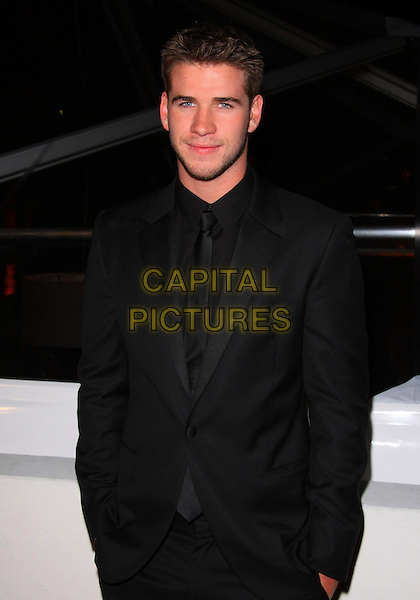 LIAM HEMSWORTH.Weinstein/Relativity Media Golden Globe Awards After Party held at The Beverly Hilton Hotel,  Los Angeles, California, USA..January 16th, 2011.half length black suit jacket .CAP/ADM/TC.©T. Conrad/AdMedia/Capital Pictures.