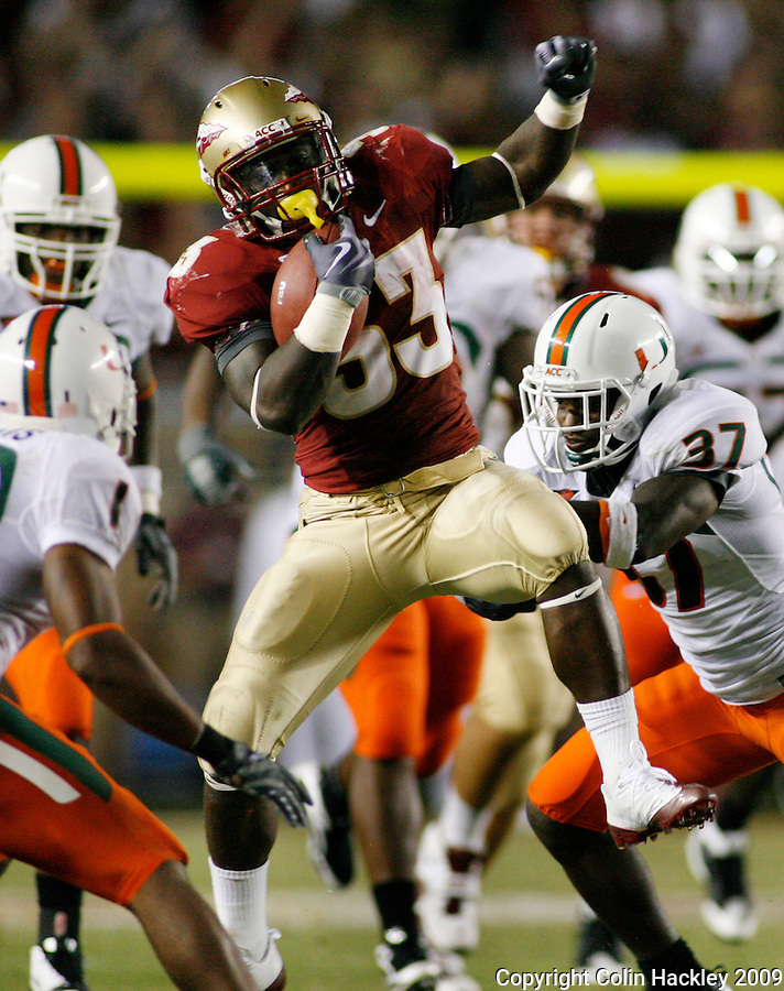 TALLAHASSEE, FL 9/7/09-FSU-MIAMIFB09 CH20-Florida State's Ty Jones jumps to avoid Miami defenders at the end of a long run in the fourth quarter, Monday at Doak Campbell Stadium in Tallahassee. The Seminoles lost to the Hurricanes 38-34...COLIN HACKLEY PHOTO