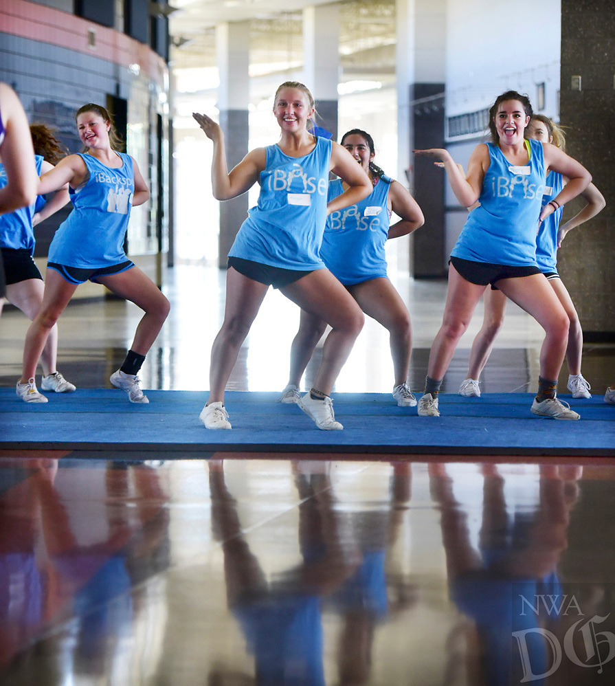 NWA Democrat Gazette/SPENCER TIREY  Morgan Byrd, center and other members of the Heritage Game Day Cheer Team member practices a routine, Thursday, July 13, 2017 at Heritage High School. The teams is doing a 3 day cheer camp put on by B2 Cheer and Dance out of Hot Springs.