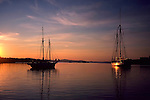Roger Crowley / CrowleyPhotos.com..Two sailboats are anchored in Pulpit Harbor along the coast of Maine...
