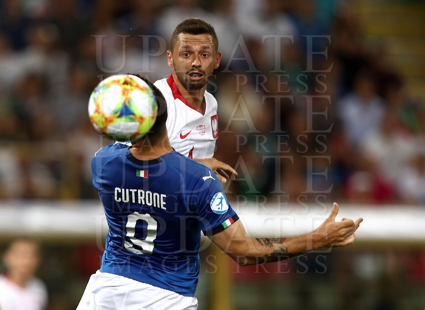 Football: Uefa under 21 Championship 2019, Italy -Poland, Renato Dall'Ara stadium Bologna Italy on June19, 2019.<br /> Italy's Patrick Cutrone (l) in action with Poland's Mateusz Wieteska (r) during the Uefa under 21 Championship 2019 football match between Italy and Poland at Renato Dall'Ara stadium in Bologna, Italy on June19, 2019.<br /> UPDATE IMAGES PRESS/Isabella Bonotto