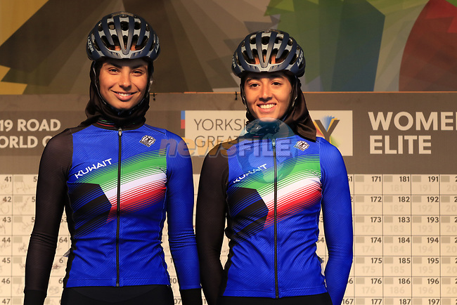Noura Alomairi and Latefa Alyaseen of Kuwait sign on for the start of the Women Elite Road Race of the UCI World Championships 2019 running 149.4km from Bradford to Harrogate, England. 28th September 2019.<br /> Picture: Eoin Clarke | Cyclefile<br /> <br /> All photos usage must carry mandatory copyright credit (© Cyclefile | Eoin Clarke)