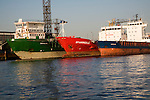 Three cargo ships moored on River Maas, Port of Rotterdam, Netherlands - 'Cedar', 'Gastrikland' and 'Spaarnedijk'