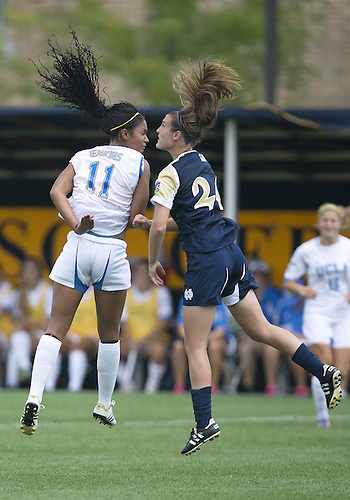 September 01, 2013:  UCLA forward Darian Jenkins (11) and Notre Dame defender Katie Naughton (24) during NCAA Soccer match between the Notre Dame Fighting Irish and the UCLA Bruins at Alumni Stadium in South Bend, Indiana.  UCLA defeated Notre Dame 1-0.