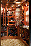 20 September 2012 -- Inspired Home Omaha Wine Cellar Burgess. Steve Burgess, architect, built a small wine cellar in the unfinished basement of his Midtown home. He designed the space, sandblasted the walls and did the carpentry work. The counter in the cellar is made from recycled green glass from wine bottles saved by the Steve and his wife, Julie. Project was a labor of love on many fronts. Picture by Daniel Johnson (Copyright 2012 Daniel Johnson)
