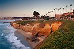Sunset light along the palm tree lined promenade and coastal cliffs at Scripps Park, La Jolla, California