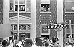 Resident of Philadelphia Ms watch from windows as the 2nd Meredith March Against Fear enters town. Photographed by Jim Peppler for essay published in The Southern Courier on June 25, 1966. Copyright Jim Peppler/1966. This and over 10,000 other images are part of the Jim Peppler Collection at The Alabama Department of Archives and History:  http://digital.archives.alabama.gov/cdm4/peppler.php