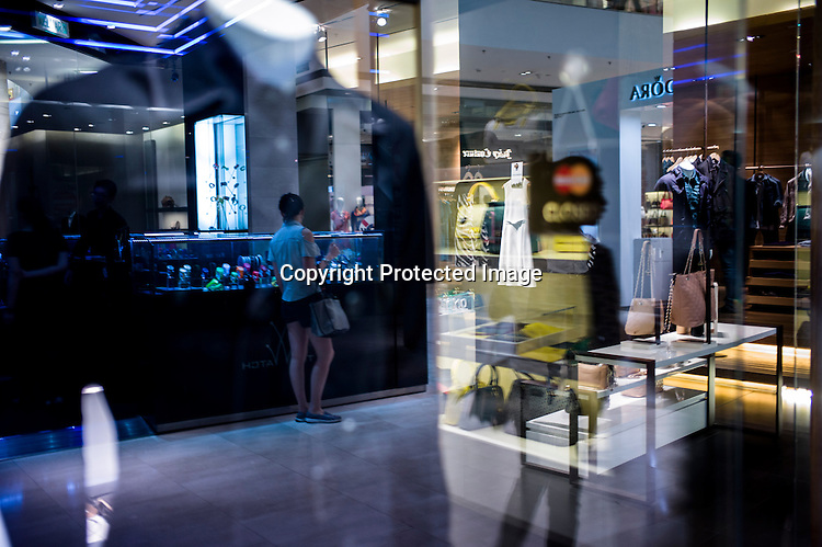 Shoppers seen browsing through a watch stall at the Pavilion, a high end shopping mall in Kuala Lumpur, Malaysia.